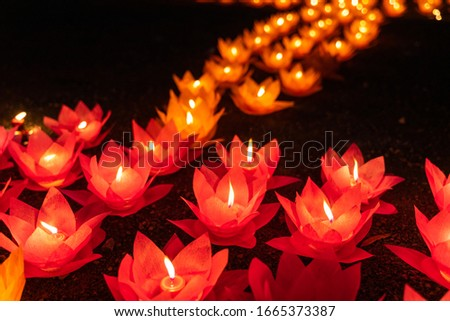 Colored lanterns and garlands at night on Vesak day for celebrating Buddha's birthday in Eastern culture, that made from paper and candle Сток-фото ©