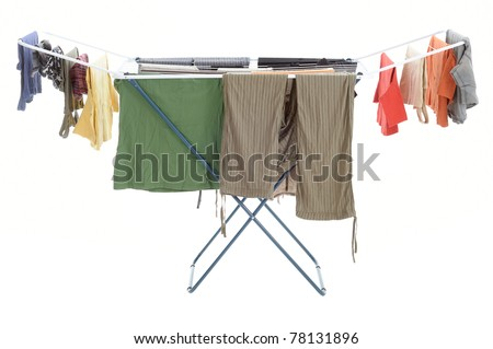 colored laundry clothes drying on the clotheshorse