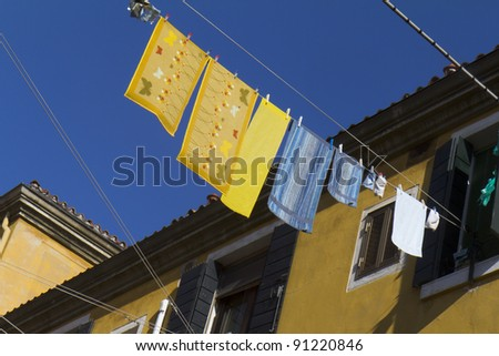 Colored  laundry hanging out on a clothesline  in the street, Venice, Italy.