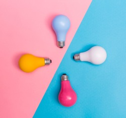Colored light bulbs on a blue and pink background