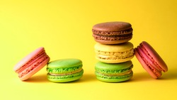 colored macaroon on a yellow background