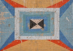 colored mosaic and square tile pattern on the old wall. decorative mosaic of different colors