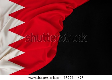 colored national flag of modern state of Bahrain, beautiful silk, black blank, concept of tourism, economy, politics, emigration, independence day, copy space, template, horizontal #1577144698