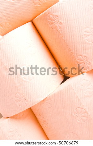 Colored orange toilet paper isolated on white background.
