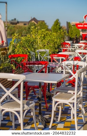 Colored outdoor restaurant furniture on green background