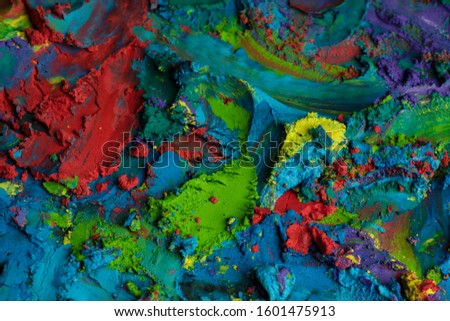 Colored paint, colored mass, colored sand. Vivid colors. Backgrounds and textures. Art and craft. Colorful frame.