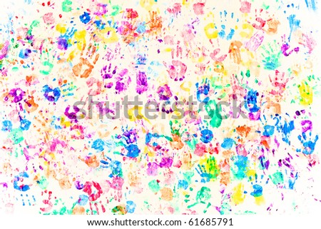 colored painted handprints on white