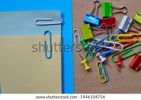 Colored paper and  clips.  Paper clips. School and office accessories