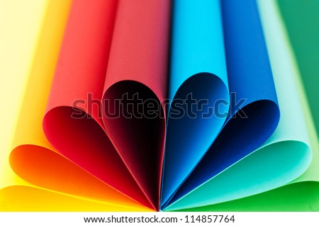 Colored paper flower in rainbow palette