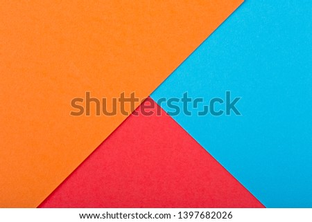 Colored paper texture. Geometric figure. Red color, orange color and blue color. #1397682026