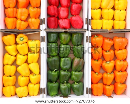 Colored paprika (pepper) in cardboard the boxes, exposed for sale