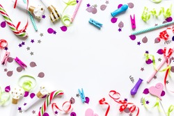 Colored party confetti on white background top view mockup