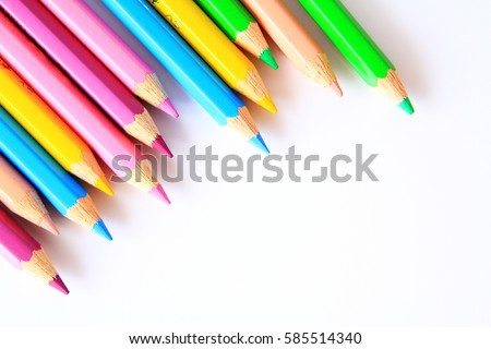 Shutterstock Colored Pencils / A colored pencil an art medium constructed of a narrow, pigmented core encased in a wooden cylindrical case.