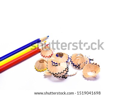 Colored pencils and Colored pencils fragments from a pencil sharpener  isolated on white background.