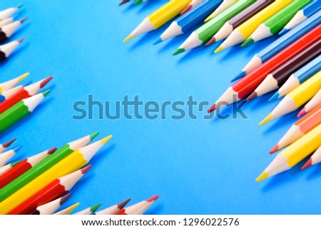 Colored pencils background.Color pencils on blue background.Close up. Many different colored pencils on blue background.Colorful pencil .Colorfull