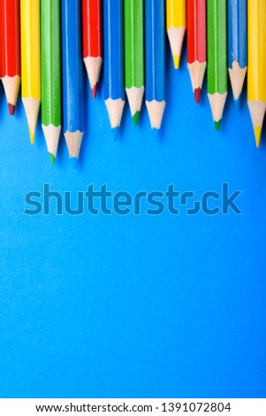 Colored pencils background.Color pencils on blue background.Close up. Many different colored pencils on blue background.Colorful pencil .Colorfull  #1391072804