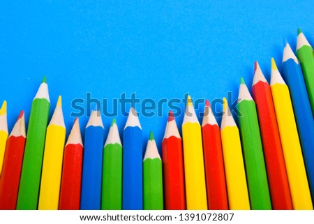Colored pencils background.Color pencils on blue background.Close up. Many different colored pencils on blue background.Colorful pencil .Colorfull  #1391072807