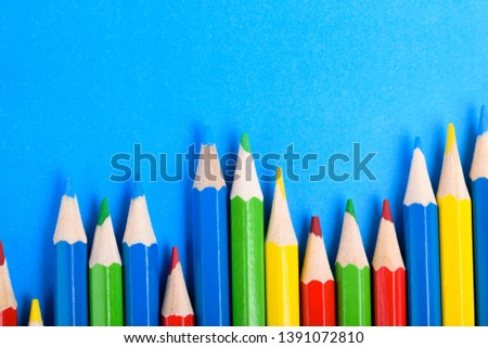 Colored pencils background.Color pencils on blue background.Close up. Many different colored pencils on blue background.Colorful pencil .Colorfull  #1391072810