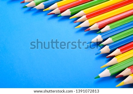 Colored pencils background.Color pencils on blue background.Close up. Many different colored pencils on blue background.Colorful pencil .Colorfull  #1391072813