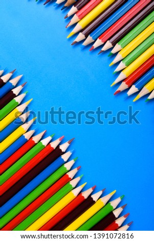 Colored pencils background.Color pencils on blue background.Close up. Many different colored pencils on blue background.Colorful pencil .Colorfull  #1391072816