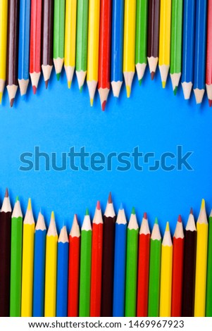 Colored pencils background.Color pencils on blue background.Close up. Many different colored pencils on blue background.Colorful pencil .Colorfull  #1469967923