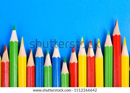 Colored pencils background.Color pencils on blue background.Close up. Many different colored pencils on blue background.Colorful pencil .Colorfull  #1512266642