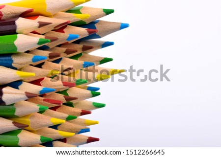 Colored pencils background.Color pencils on blue background.Close up. Many different colored pencils on blue background.Colorful pencil .Colorfull  #1512266645