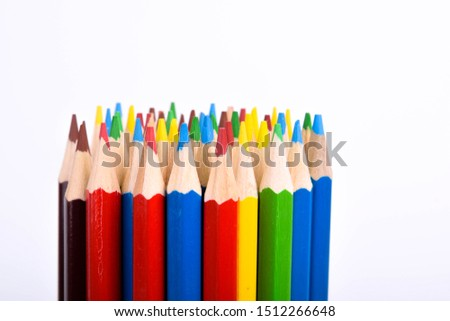 Colored pencils background.Color pencils on blue background.Close up. Many different colored pencils on blue background.Colorful pencil .Colorfull  #1512266648