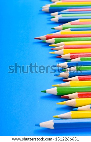 Colored pencils background.Color pencils on blue background.Close up. Many different colored pencils on blue background.Colorful pencil .Colorfull  #1512266651