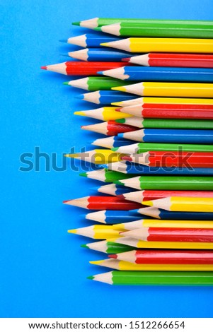 Colored pencils background.Color pencils on blue background.Close up. Many different colored pencils on blue background.Colorful pencil .Colorfull  #1512266654