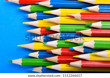 Colored pencils background.Color pencils on blue background.Close up. Many different colored pencils on blue background.Colorful pencil .Colorfull  #1512266657