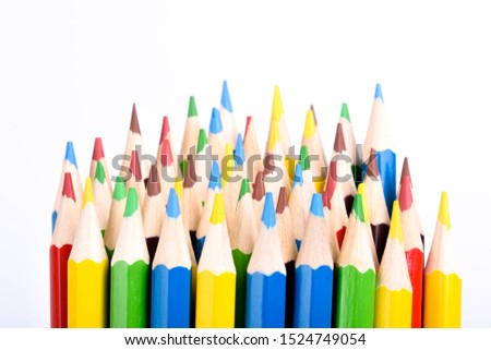 Colored pencils background.Color pencils on blue background.Close up. Many different colored pencils on blue background.Colorful pencil .Colorfull  #1524749054