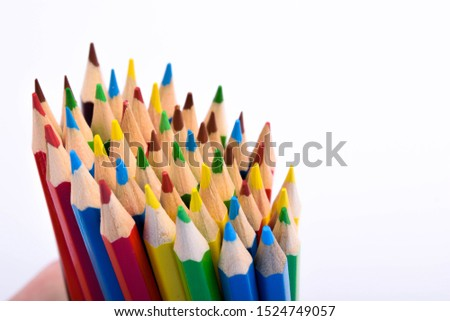 Colored pencils background.Color pencils on blue background.Close up. Many different colored pencils on blue background.Colorful pencil .Colorfull  #1524749057