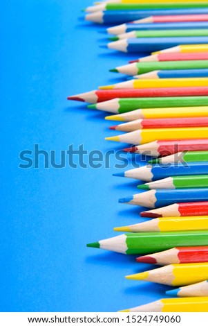 Colored pencils background.Color pencils on blue background.Close up. Many different colored pencils on blue background.Colorful pencil .Colorfull  #1524749060