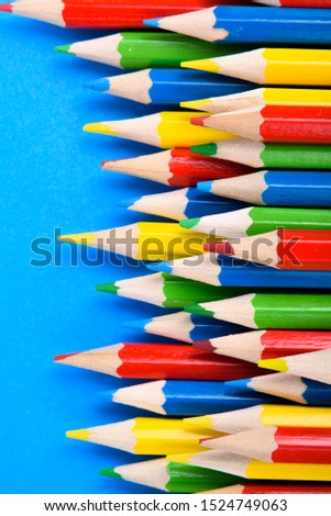 Colored pencils background.Color pencils on blue background.Close up. Many different colored pencils on blue background.Colorful pencil .Colorfull  #1524749063