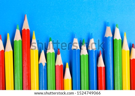 Colored pencils background.Color pencils on blue background.Close up. Many different colored pencils on blue background.Colorful pencil .Colorfull  #1524749066