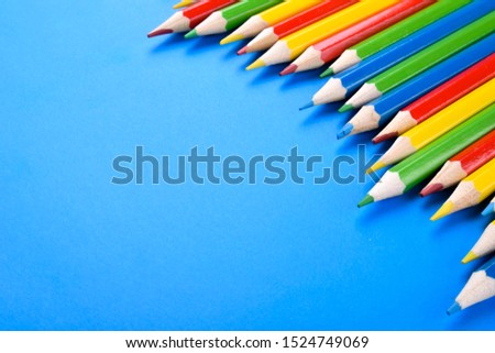 Colored pencils background.Color pencils on blue background.Close up. Many different colored pencils on blue background.Colorful pencil .Colorfull  #1524749069