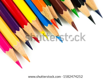 Photo of  Colored pencils background. Color pencils on white background.
