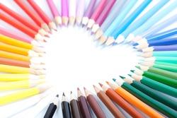 Colored pencils heart shape (shallow focus)