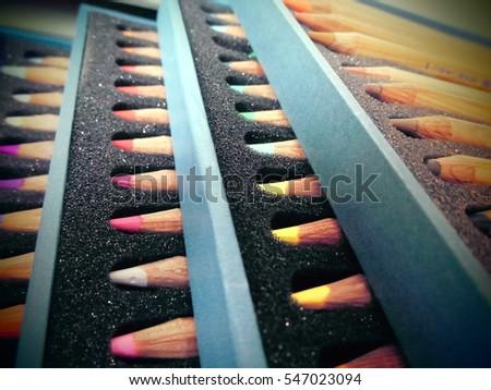 Colored pencils in a box. #547023094