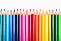 Colored pencils in rainbow order