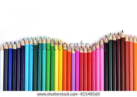 Colored pencils lined up in  row