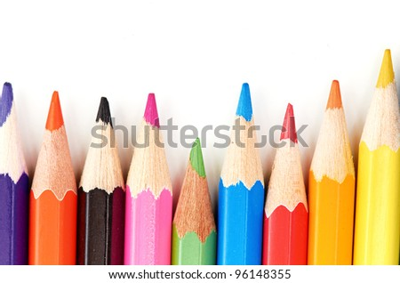 Colored pencils macro as background with space for text