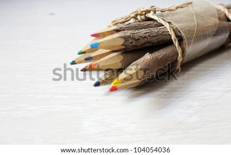 Colored pencils made ??with wood branches
