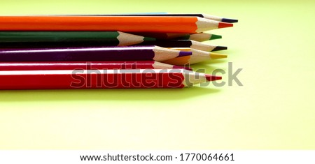 Colored pencils on a white background. Lots of different colored pencils. Colored pencil. Pencils are sharp. Pencils lie on the left. Beautiful background. Close-up. Copy space. Background. Flat lay