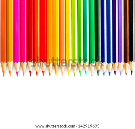 Colored pencils rainbow on white background