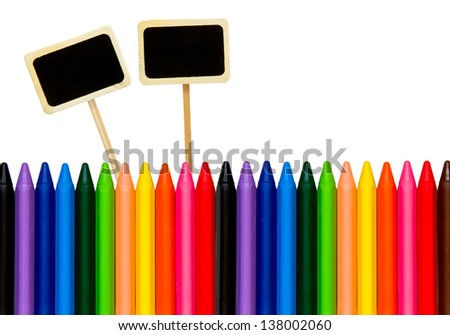 colored pencils with a little black boards isolated on white