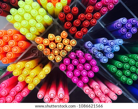Colored pens on shelves In the shop,Office supplies and stationery. Colorful pens arranged on shelves selling stationery. Multicolored markers in art store. Art, workshop, craft, creativity concept.