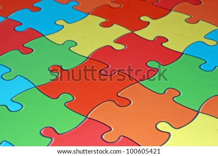 colored pieces of a complicated puzzle used as flooring in a school - stock photo