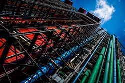 Colored pipes on Centre Goerge Pompidou in Paris under blue sky with small cloud